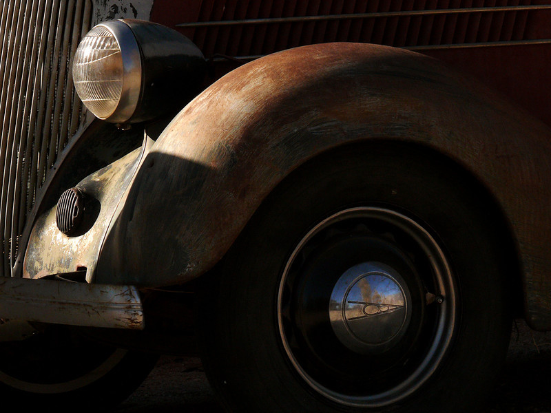 Fender, Lone Pine, California - This old car was parked in a field near the old Lone Pine train depot. The owner enjoys restoring cars -- perhaps these wheels will turn again, someday.