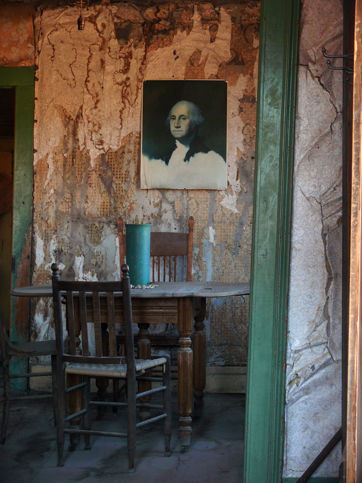 House interior, Bodie - This house is, by all standards, a ruin. Yet the table is ready for dinner, and an incongruous portrait of George Washington looks upon the scene without visible concern. This image asks us to consider the nature of a ruin – at what point does a house become unlivable? The greens and golds in this photo are hauntingly beautiful, even if the walls seem to be on the verge of crumbling. I made this image through a window, and the digital image is far brighter and much more vividly colored than the scene I saw with my own eyes.