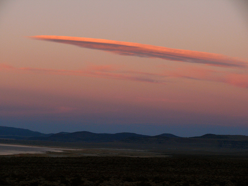 Afterglow, Mono Lake - The shape and coloration of this cloud is unique – some call it a Sierra cloud. A giant spear of pink, the well-defined cloud echoes the lighter, more diffused clouds behind it.