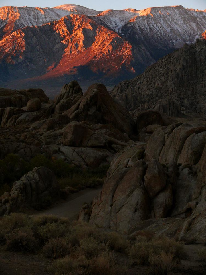 Sunset in the Alabama Hills - The setting sun reveals the ancient texture of these hills, arranged along a gradually receding diagonal line. These rocky surfaces look very familiar. They provided the background for dozens of western movies. The Alabama Hills are located just outside of Lone Pine, California.
