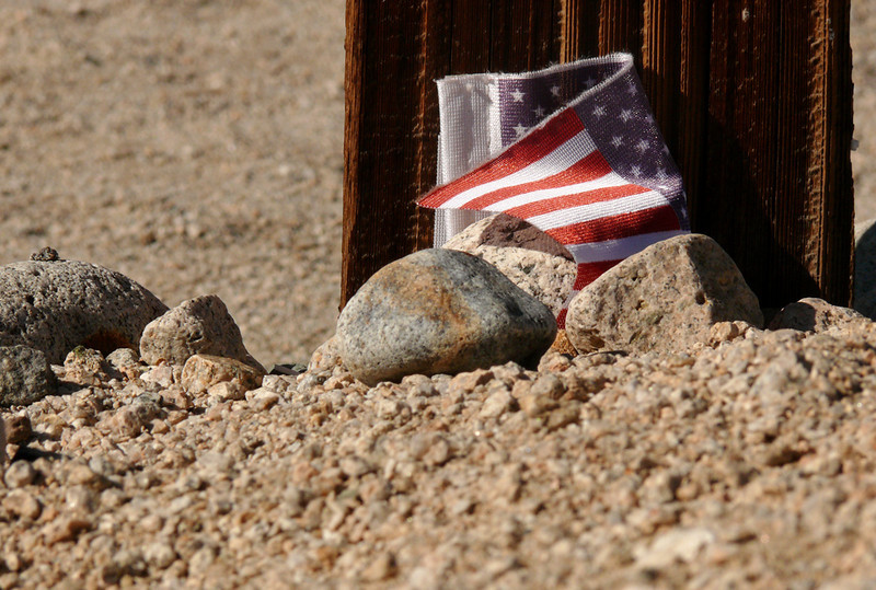 Patriot's grave, Manzanar Cemetery - A tiny American flag marks the grave of a Japanese American who died in the Manzanar Relocation Camp during World War II.