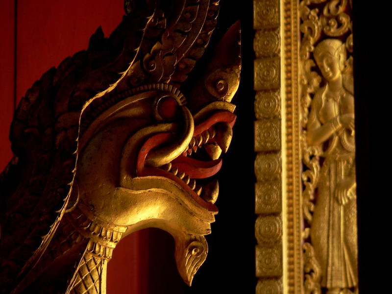 Royal Cremation Chariot, Luang Prabang - One of the many Naga heads that adorn the funerary chariot now stored in one of Luang Prabang's magnificent temples which once carried the Kings of Laos to their funeral pyres.