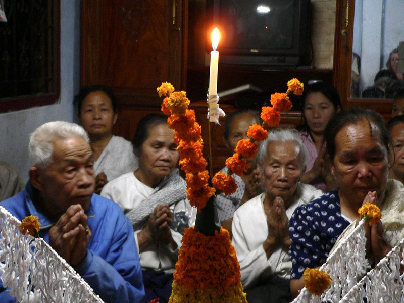 Prayers, Baci Ceremony, Luang Prabang - We were fortunate to be invited into a private home in Luang Prabang where a Buddhist Baci ceremony was performed in our honor. This ceremony wished us good fortune and welcomed us to the most beautiful city in Laos.