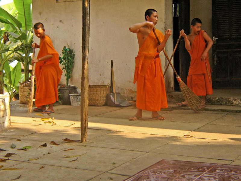 Dust Patrol, Luang Prabang - Like all Laotian cities, Luang Prabang is dusty. Its public streets are left to accumulate layers of it, but its vast temples are kept gleaming by the flying brooms of their young monks.