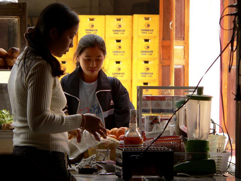 Fast food in Huay Xai - A local restaurant saves villagers a trip to the market by offering produce and sandwiches at its street-side counter.