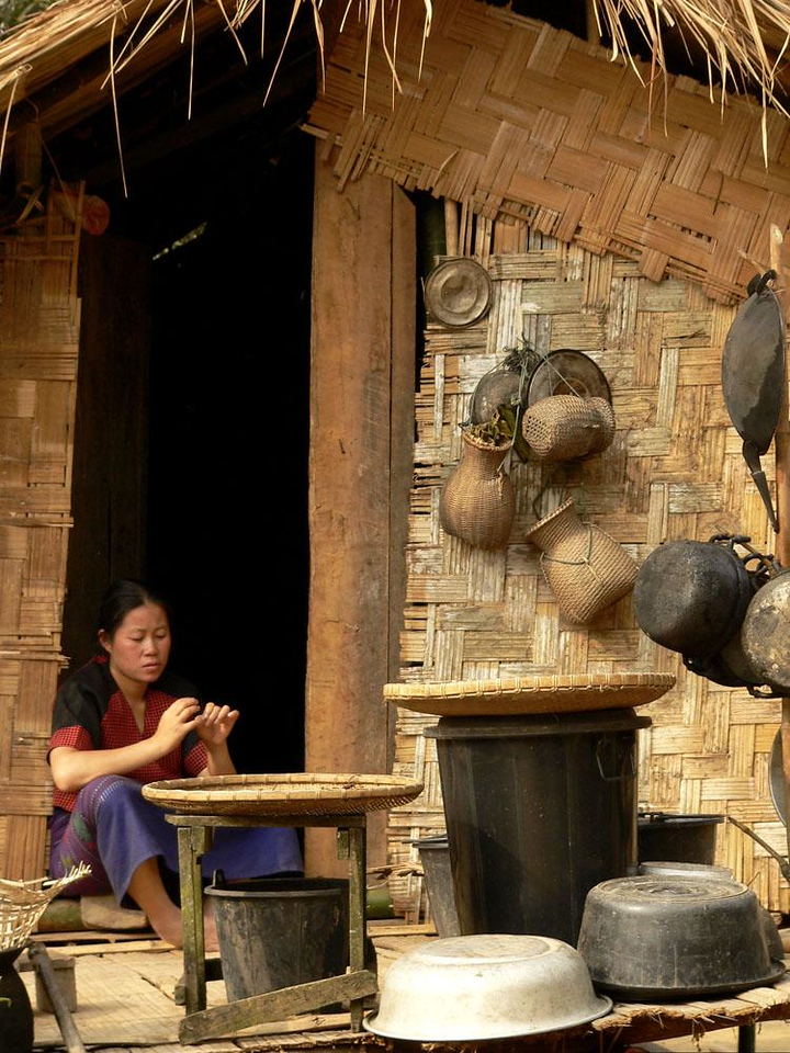 Hmong kitchen, near Pak Beng - An array of baskets, pots, pans and trays in a well-stocked Hmong outdoor kitchen.