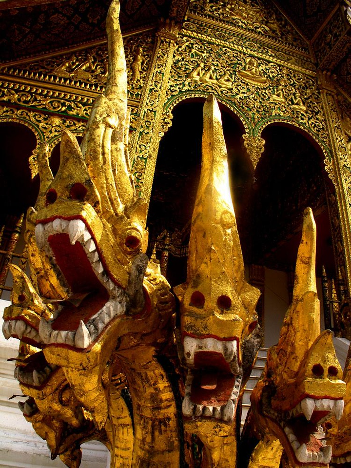 Four Nagas, Luang Prabang - These dragon like creatures guarding Buddhist temples in Laos actually represent serpent-gods. Nagas have long been associated with wisdom and immortality and appear in various forms at places of worship in Egypt, China, India, Central and South America and and throughout Indochina. In Myanmar (Burma) they are called Nats.