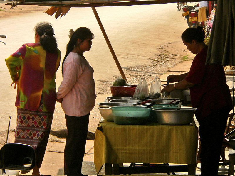 Waiting for noodles, Huay Xai - Customers wait for their hot noodles at a street vendor's stand.