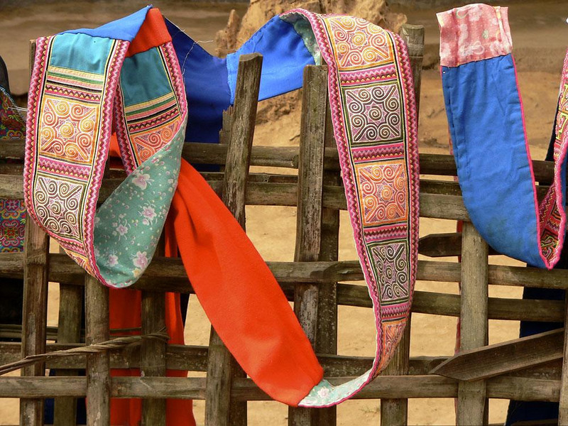 Hmong sash, near Pak Beng - We visited a number of river villages settled by Hmong people. I saw this sash drying on a fence near Pak Beng.