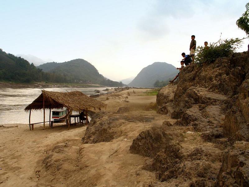 River landscape at Banlathan - Village children greet tourists boats on the Mekong at Banlathan.
