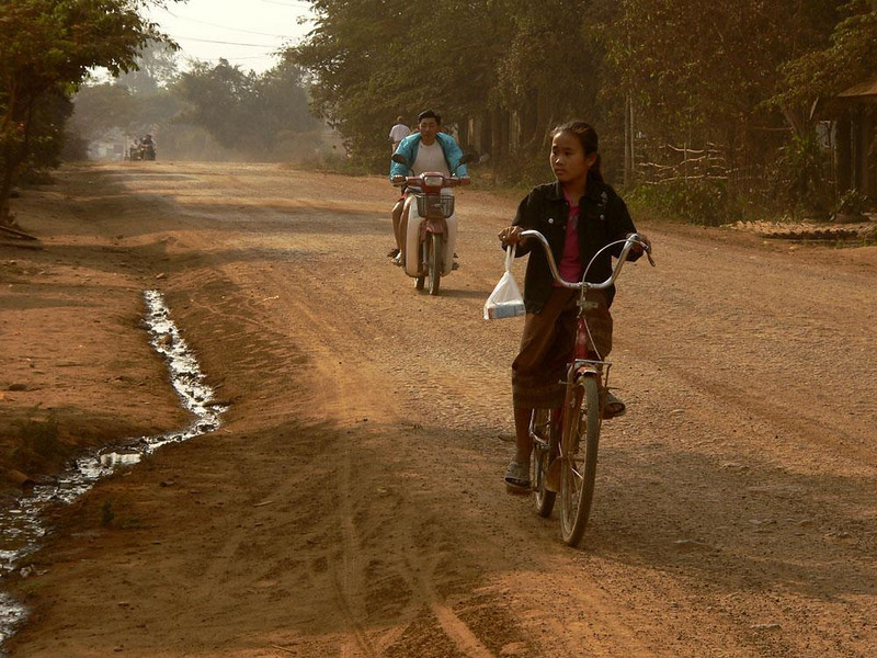 Cyclists near Huay Xai - Most Laotian roads are dirt, and most vehicles are pedaled.