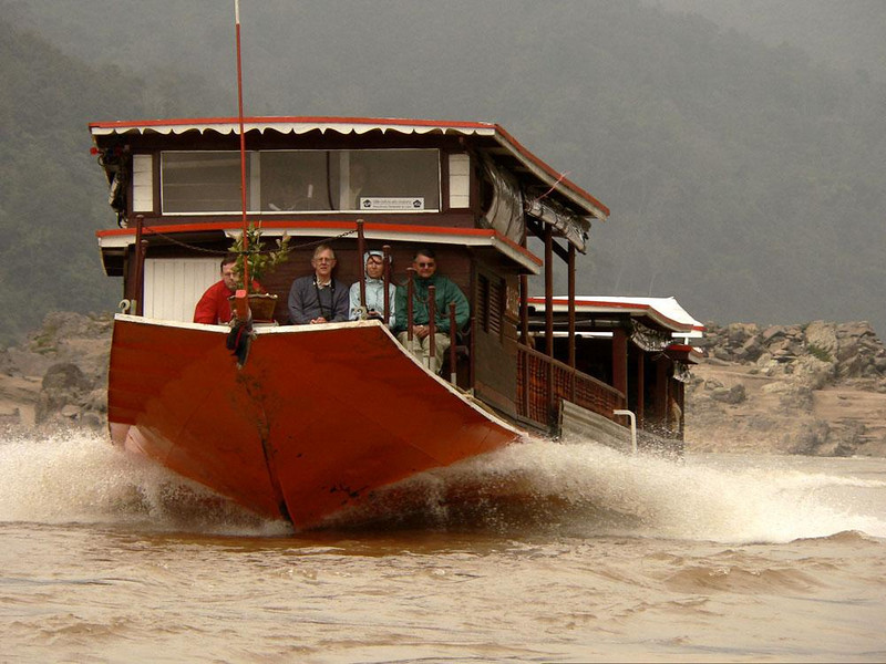 Tourists on the Mekong - Colorful boats carry foreign tourists swiftly along the Mekong River in comfort.