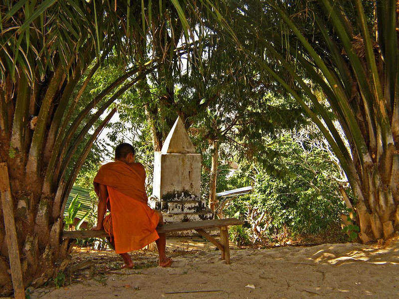 Meditation on the Mekong - We traveled the waters of the Mekong for three days between the Laotian border and the formal royal capital of Luang Prabang. Here a monk meditates near the river, just outside the temple of one of the river villages we visited.