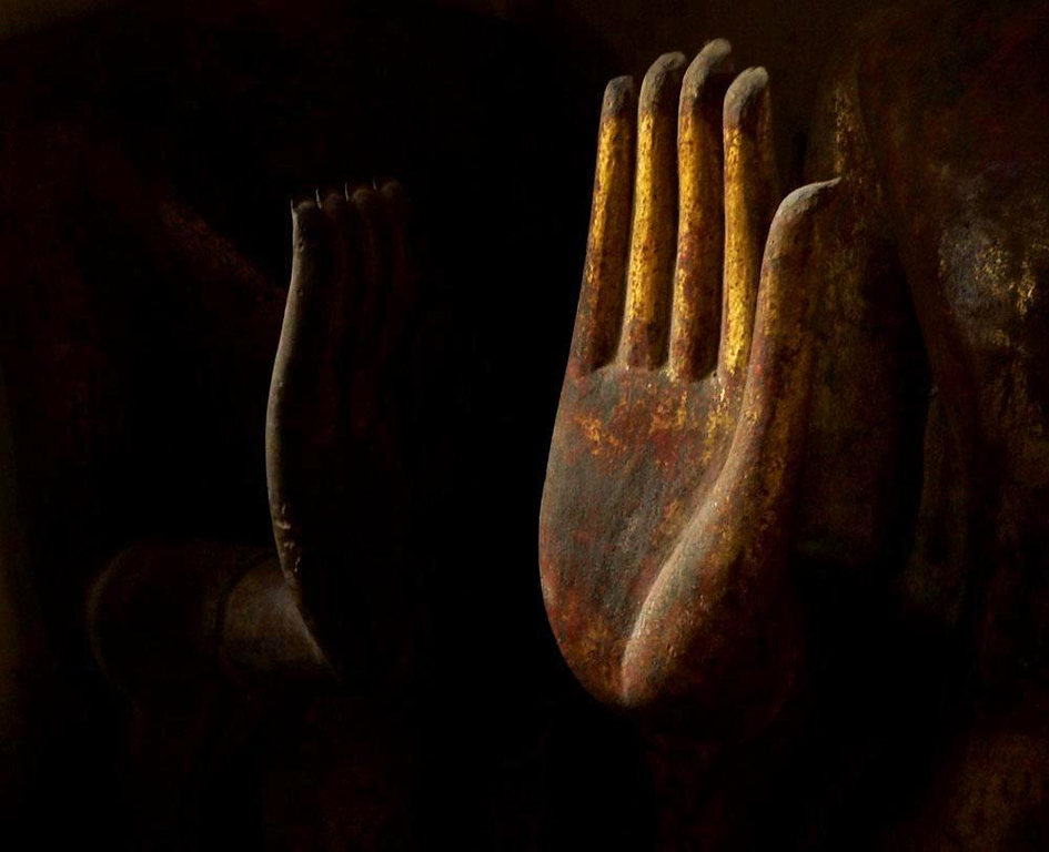 Hands, Luang Prabang - Some say that Luang Prabang is the most peaceful city in Asia. I found my own symbol for this peace in the play of light on the hand of a Buddha image stored in a darkened corner of an ancient Luang Prabang temple.