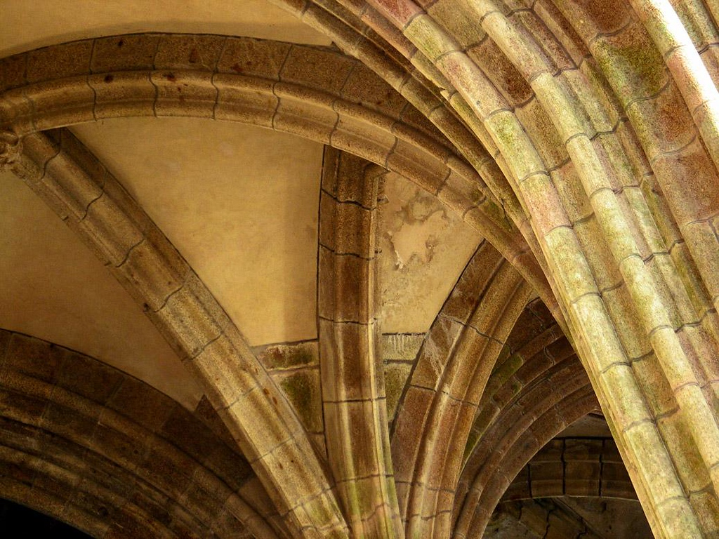 Crypt, Mont St. Michel - The Abbey's Church, which stands at the very top of the Mount, is supported by a series of crypts under its floor. The ceilings of the crypts are braced by soaring vaults that have supported the church's weight for a thousand years.