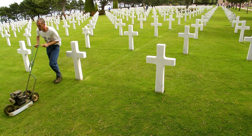 GI Cut, US Cemetery, Omaha Beach - Viewing the precisely aligned headstones against the immaculately maintained emerald green lawn conveys an unforgettable feeling of peace and serenity. The cemetery is so vast that there is always some lawn work going on.