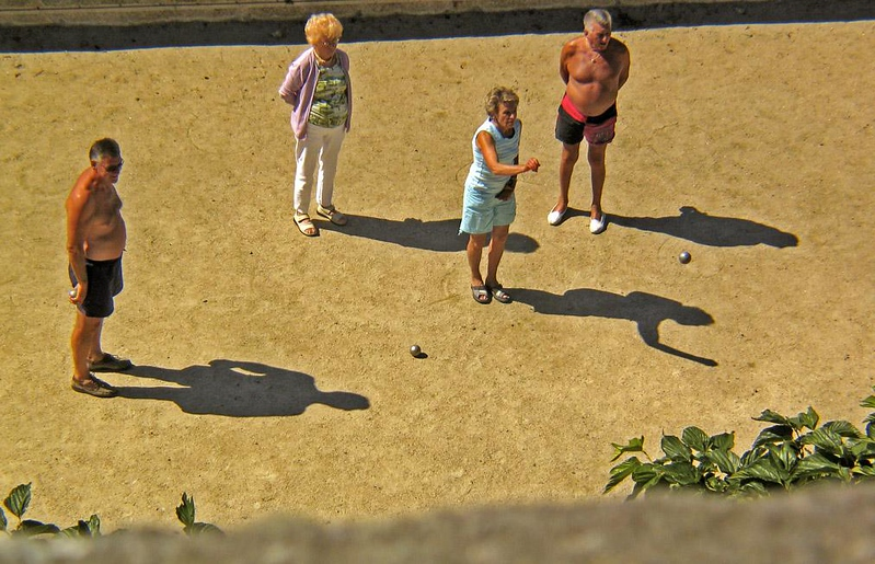 Shadows, St. Malo Beach - Shooting down from the Ramparts of St. Malo on its lovely beaches, I noticed this quartet enjoying a friendly competition. Then I looked again at the scene, and noticed that the shadows made it an octet!