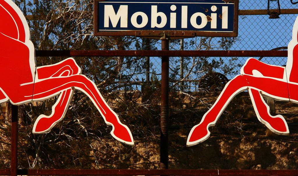 Gas station sign - The collection of automotive antiquities at Tom's Welding and Machine Shop in Barstow contains signs bearing an array of nostalgic logos from the American Road. I emphasize here the flying feet of the famous winged horses that once promoted Mobiloil.