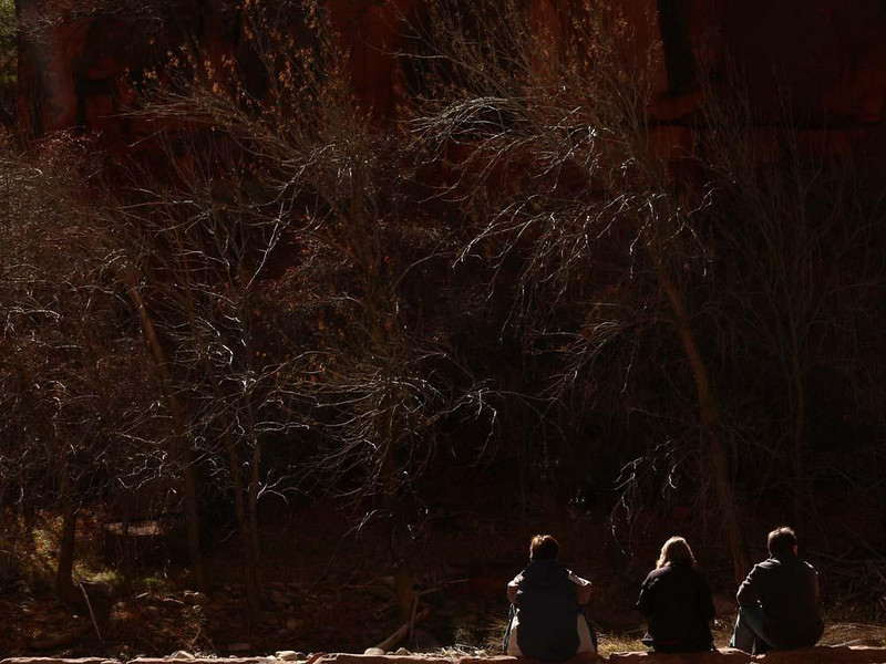 Hikers at rest - A trio of hikers take a breather on the banks of Zion's Virgin River.