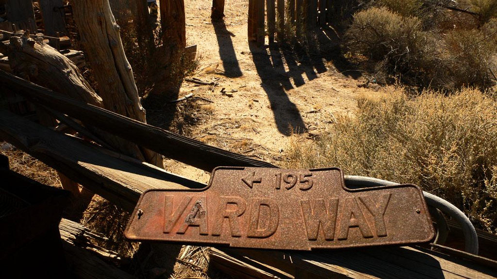 Street sign, Route 66 - A long discarded street sign is among the relics on view in an abandoned complex of buildings on Route 66 at Newberry Springs, California