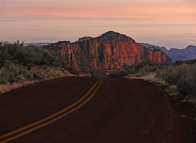 Zion Sunset - I used the flow of Zion's red Kolob Terrace Road to pull us over this hill and draw us down to the majestic sandstone cliffs at its base.