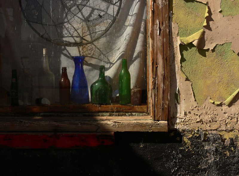 Restaurant window - Someone has placed old bottles and a dreamcatcher in the window of an abandoned gas station on Route 66 in Newberry Springs, California.