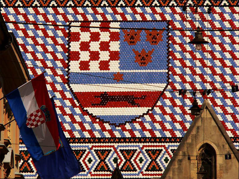 Tiled View - The tiled roof of Zagreb's Church of St. Mark bears the coats of arms of Croatia, Dalmatia, Slavonia and Zagreb. Here, one of those coats of arms almost fills the view down Cirilometodska Street.