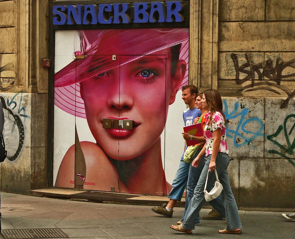 Strange snack in Zagreb - This snack bar is closed, but a huge face seems to be snacking on its door handle, adding a bizarre dimension to the sea of graffiti in downtown Zagreb.