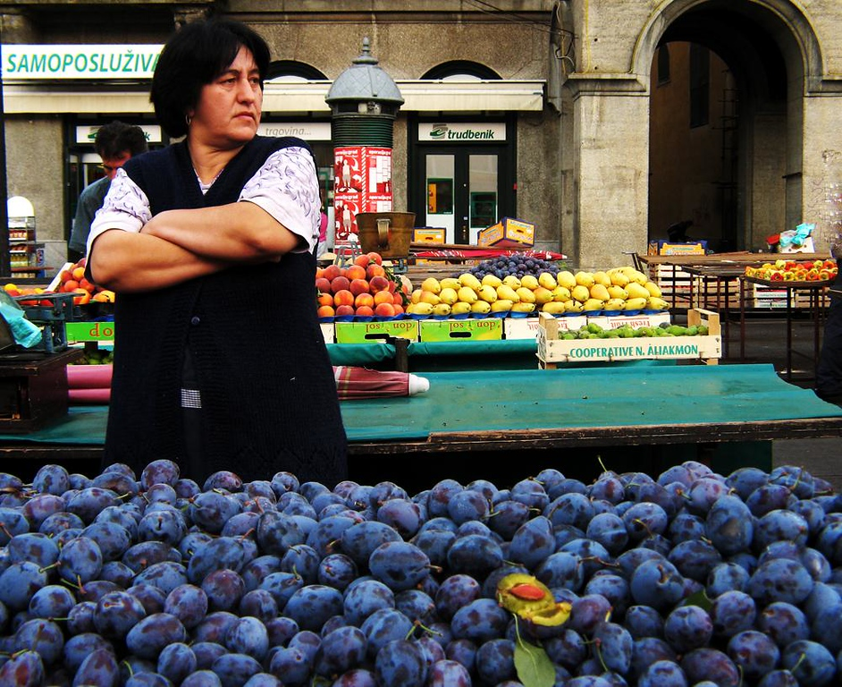Plum Job - It's early morning in Zagreb's Dolac Market, and a plum seller awaits her first customers of the day.