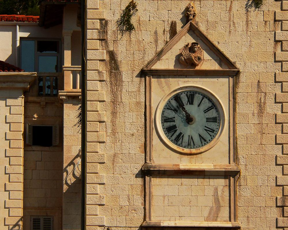 Clock Tower, Hvar Town - The traffic free marble streets of medieval Hvar have a Venetian feel to them because Venice ruled the city when its historic buildings were built. The symbol of Venetian Power, the winged lion, can still be seen on the city's clock tower.