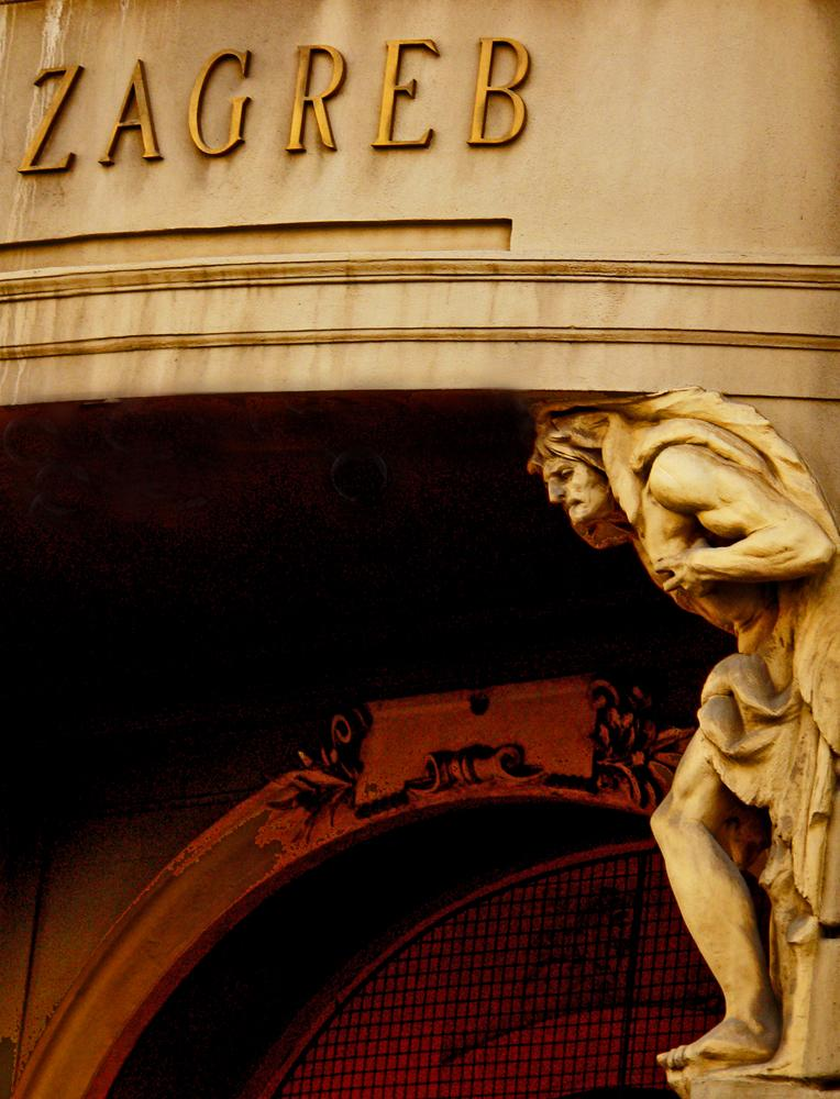 Heavy lifting - One of two giant figures bearing the load of an entrance way to a 19th century Zagreb commercial building.