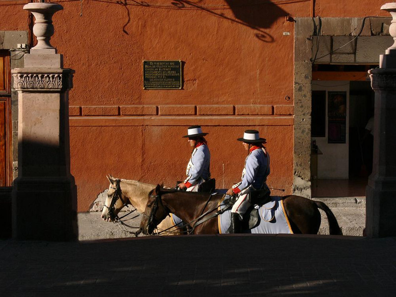 Mounted Patrol, San Miguel - Two policemen, wearing traditional costumes, patrol the streets and plazas of San Miguel.