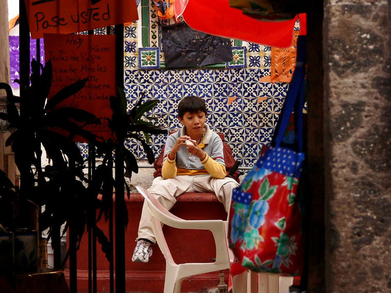 After school treat - Ice cream is popular in Mexico. This young man is enjoying his in the patio of a restaurant.