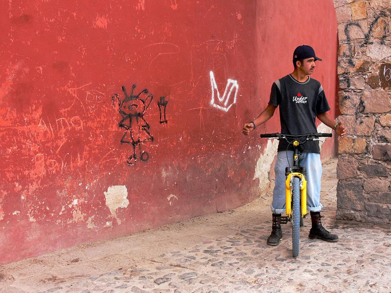 Cyclist, Guanajuato - This man catches a breather beneath the arches supporting Guanajuato's Church of Valenciana.