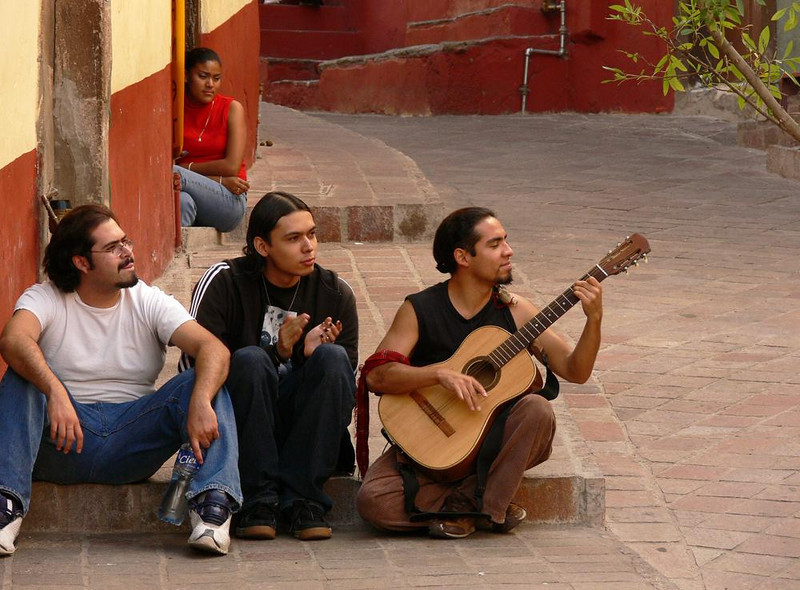 Musician, Plazuela del Baratillo - Guitar music soothes afternoon listeners on one of Guanajuato's smallest plazas.