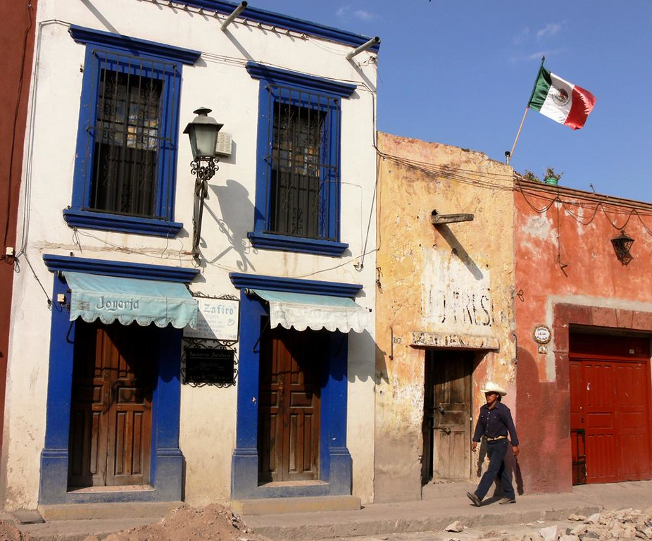 Under the flag in San Miguel - San Miguel's old streets show the wear and tear of time, and proudly so.