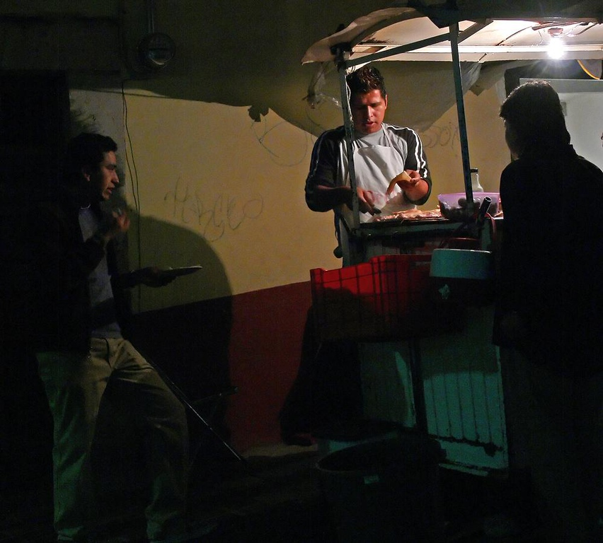Street Food, Plazuela del Baratillo - As night comes to this tiny plaza in the center of Guanajuato, patrons line up for a quick snack from one the many food vendors who take over its sidewalks.