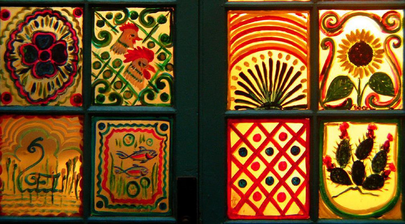 The Windows of La Fonda - The dining room at Santa Fe's historic La Fonda Hotel features New Mexican folk art on its many windows.