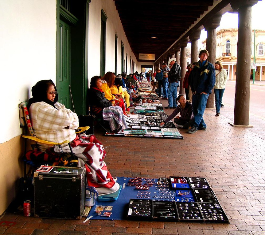 Slow day at the Palace of the Governors - On a cold spring day, Native American crafts sell slowly in front of the oldest public building in the US, Santa Fe's Palace of the Governors. It was first a fort and seat of the Spanish Government, and later the home of Territorial Governors. Today it is a musuem that dominates one side of Santa Fe's famous Plaza.