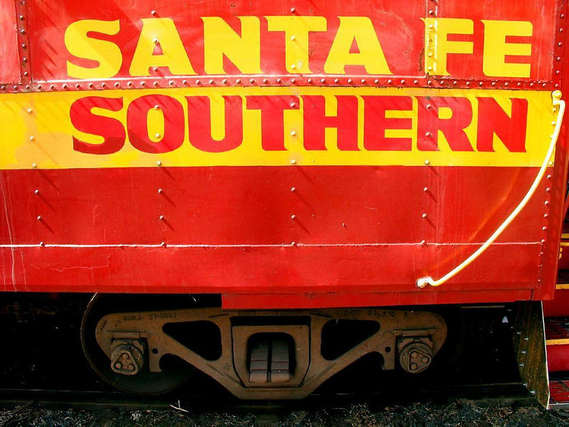 All aboard! - The colorful logo of the Santa Fe Southern Railroad still graces this passenger car now parked permanently in Santa Fe's old railroad yard.