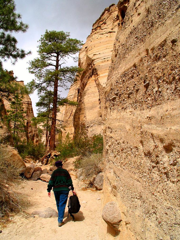 Trek to the box canyon, Tent Rocks - A photographer begins her one-mile, one-way walk into the magnificent box canyon at Tent Rocks National Monument.