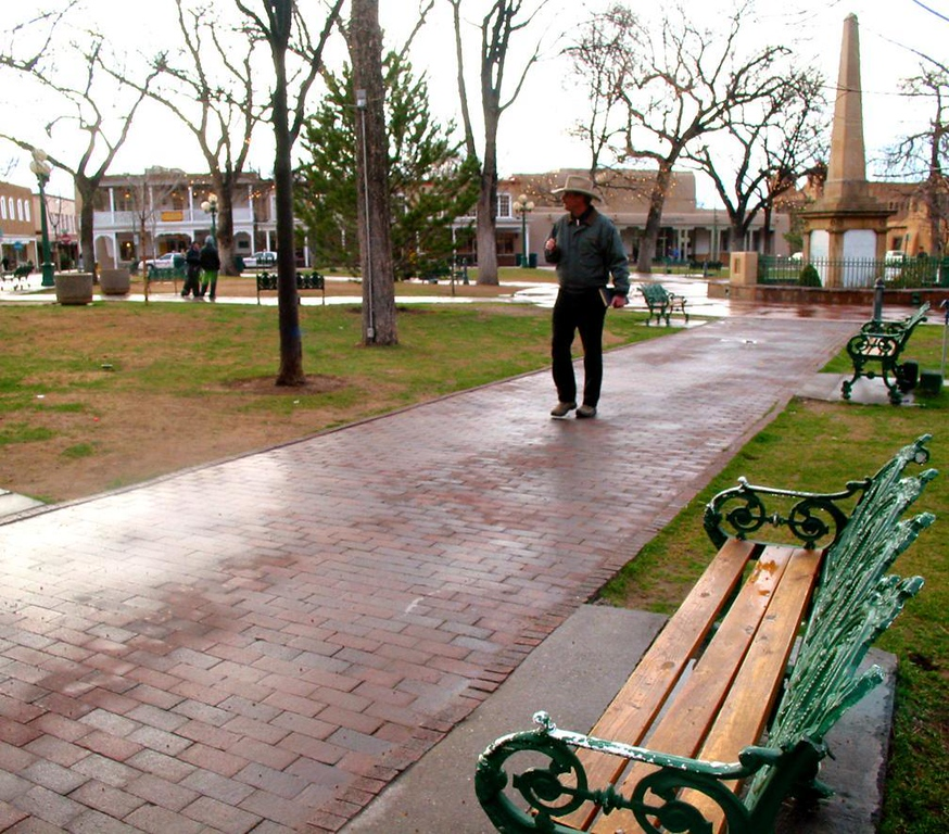 After the rain: Santa Fe's Plaza - Remnants of a cold rain glisten on the brick paths of Santa Fe's historic Plaza. The obelisk hails the heroes of New Mexico's 19th Century Indian Wars.