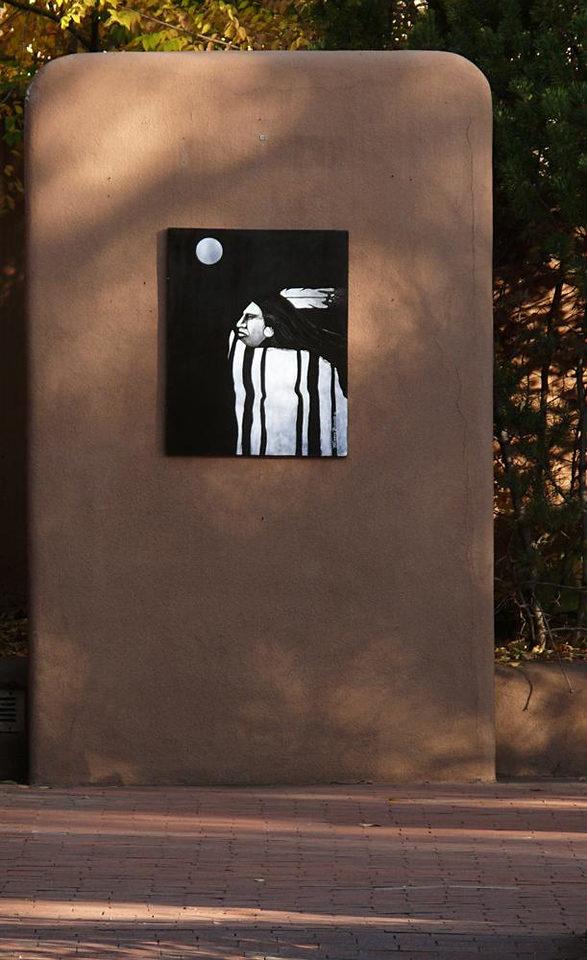 In memoriam - The last image I made in Santa Fe, and quite fittingly one of the last of my entire journey through Indian Country, was this photograph of an art print mounted on a wall that to me appeared to be shaped like an oversized grave marker. The artist portrays an idealized Indian, brooding under a stylized moon. Yet when I walked back and photographed it from a distance, it appeared to become a memorial to a vanishing culture.