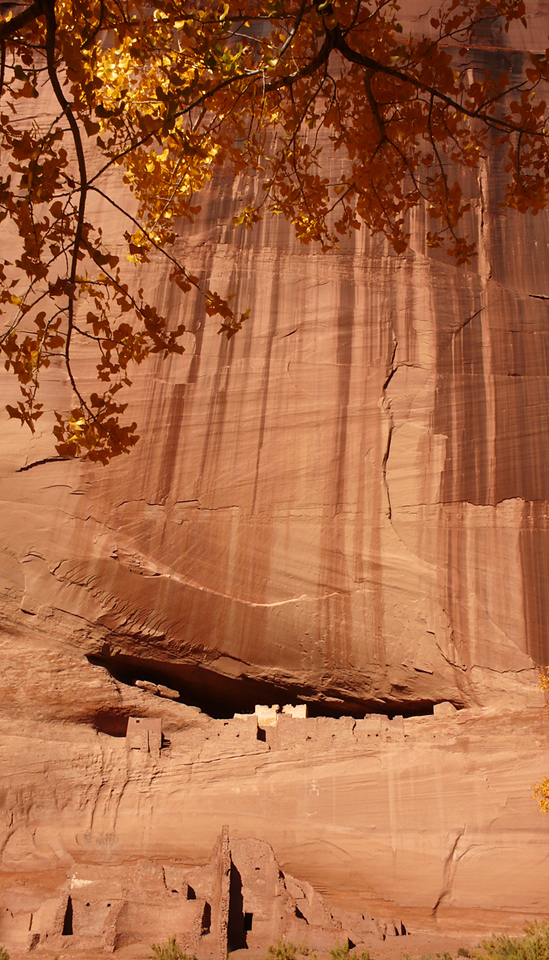 White House Ruin in context - The thousand foot high cliffs of Canyon de Chelly rise straight up from the canyon floor, overshadowing everything down below, including the ancient ruins known as The White House.