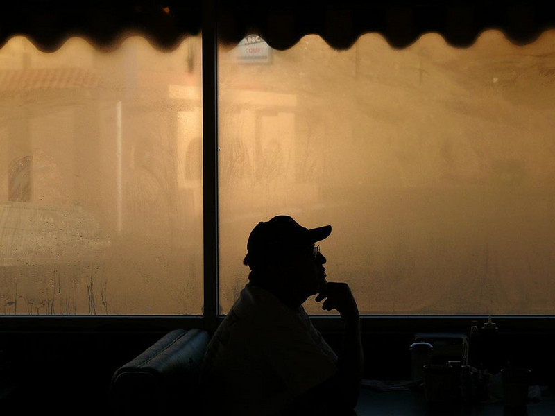 Morning thoughts, Farmington - I found this man having breakfast at a pancake house in the town of Farmington, New Mexico. It was a cold sunny morning, and its big windows were rich in golden condensation. For this customer, it seemed a place for dreams as much as a place for pancakes.