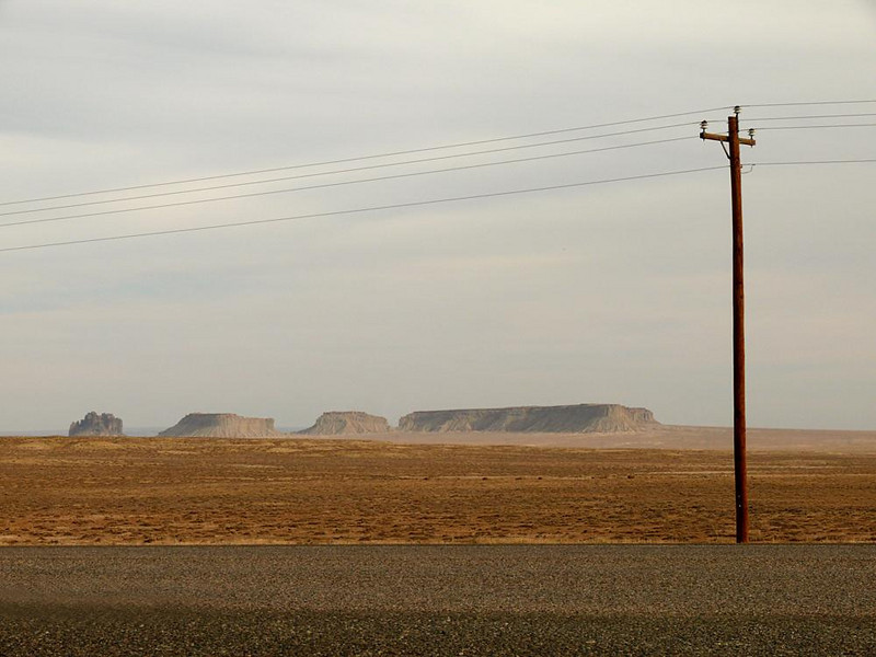 Navajo Reservation, Northern New Mexico - The Navajo homeland covers 26,000 square miles, occupying all of Northeastern Arizona and spilling over into Utah and New Mexico. Much of it looks like this -- high desert, buttes and mesas, and long roads lined with utility poles such as this one.