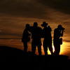 Camaraderie at day's end - A spectacular sunset at El Malpais, near Gallup, New Mexico, proves to be a bonding experience for a group of photographers.