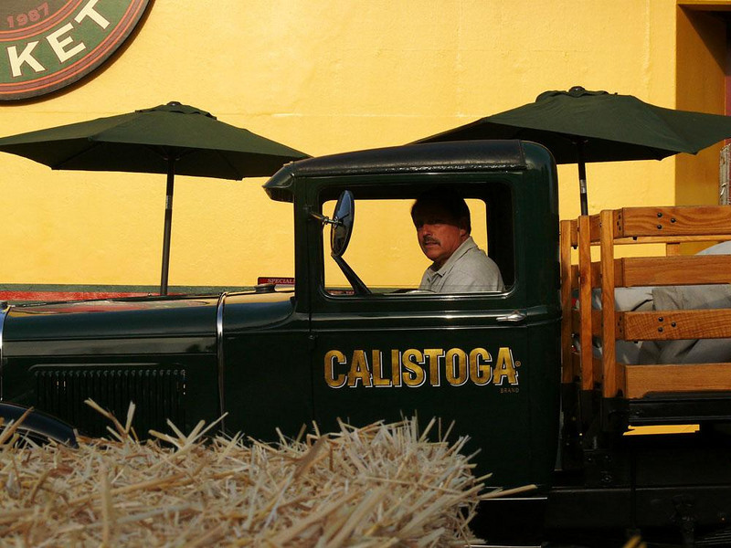 Living history, Petaluma, California - This man restored and maintains this old delivery truck -- I photographed him at the anniversary celebration of a local market.