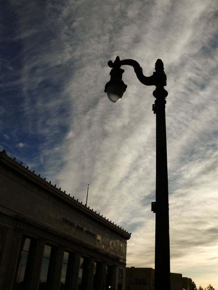 Dawn, Petaluma, California - Dawn clouds fan out over an old bank, which now houses an antiques collective.