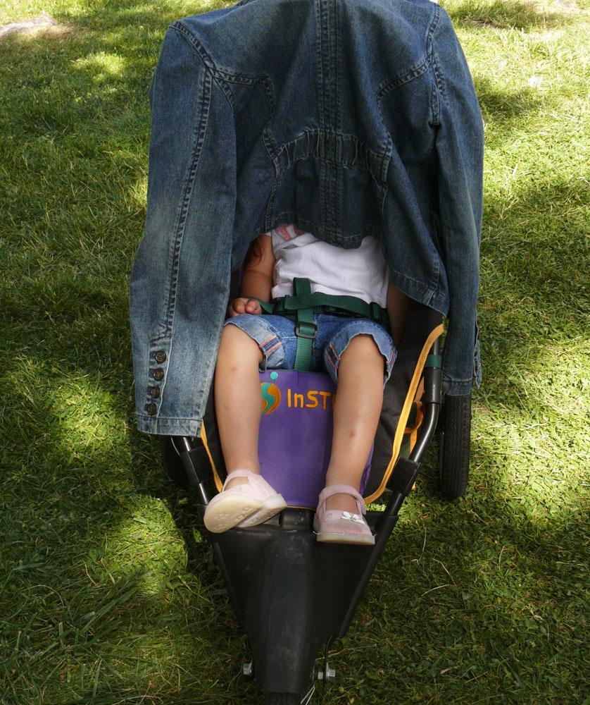 Asleep at Petaluma Farmer's Market - A double dose of shade helps this small sleeper to slumber.